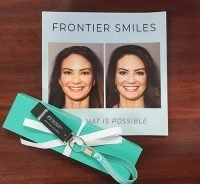 picture of frontier smiles book and Frontier flash drive