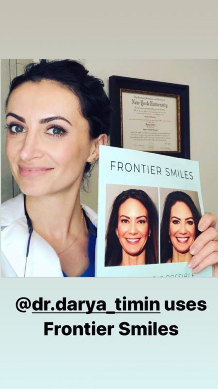 doctor darya timin holding the frontier smiles book