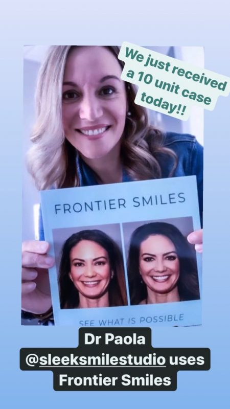 sleeksmilestudio doctor paola holding the frontier smiles book